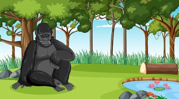 Gorille dans une scène de forêt ou de forêt tropicale avec de nombreux arbres