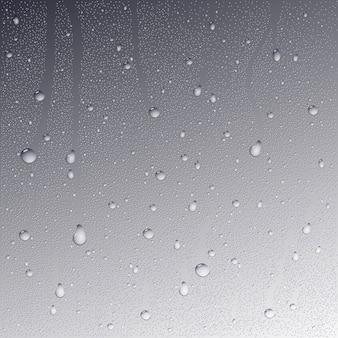Gouttes d'eau sur fond de verre.