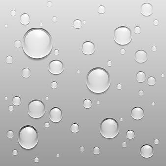 Gouttes d'eau sur une surface grise