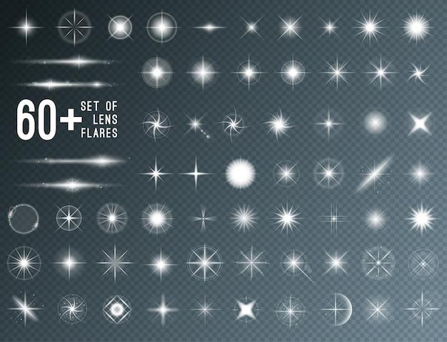 Grand ensemble de lumières d'étoiles évasées de lentilles réalistes et d'éléments blancs brillants sur fond transparent