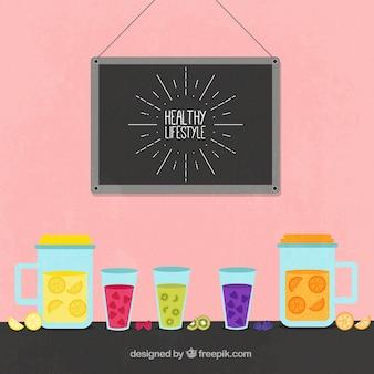Grand fond avec des jus de fruits et un tableau noir