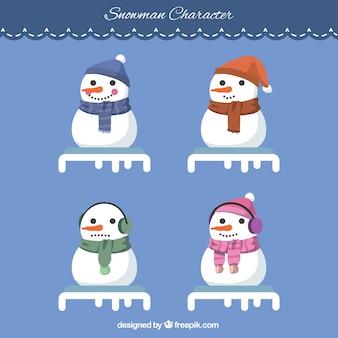Grand jeu de bonhommes de neige heureux avec des foulards