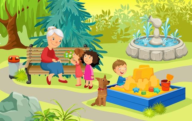 Grand-mère et petits-enfants dans le parc