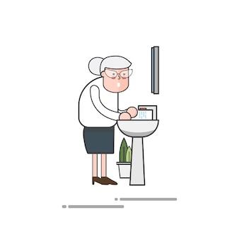Grand-mère se lave les mains