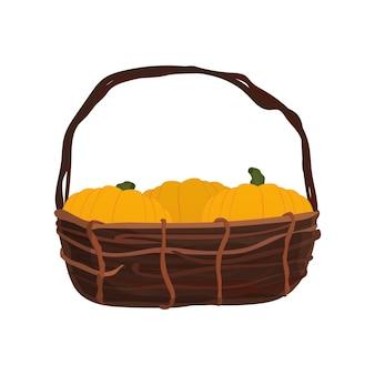 Grand panier avec des citrouilles. panier en osier. citrouilles. bon pour la conception sur le thème d'halloween, isolé. vetkor.