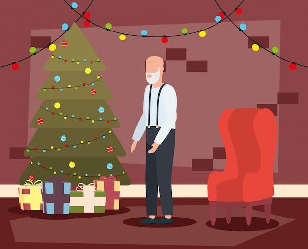 Grand-père dans le salon avec une décoration de noël
