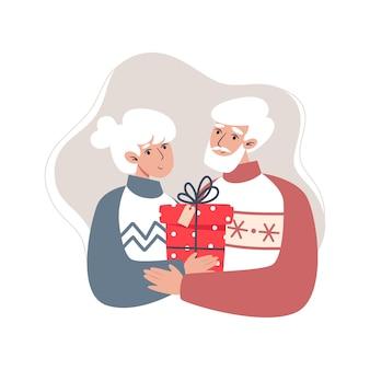 Grand-père et grand-mère tenant un cadeau