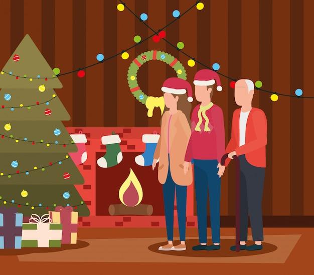 Grand-père mignon avec jeune couple dans la chambre décorée de noël