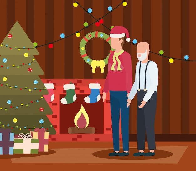 Grand-père mignon avec jeune fils dans la chambre décorée de noël
