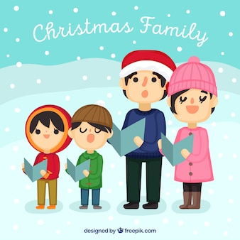 Grande famille chantant un carol un jour de neige
