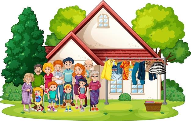 Grande famille debout à l'extérieur de la maison isolée