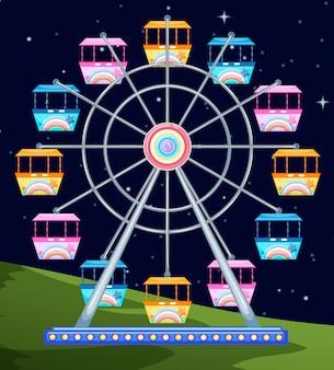 Grande roue qui tourne la nuit