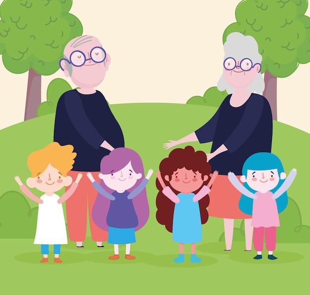 Grands-parents avec enfants dans le parc