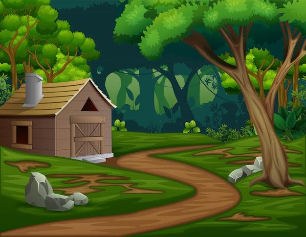 Une grange ou une maison au milieu de la forêt