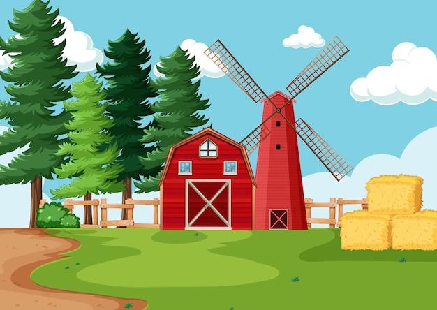 Grange rouge et moulin à vent en scène de ferme