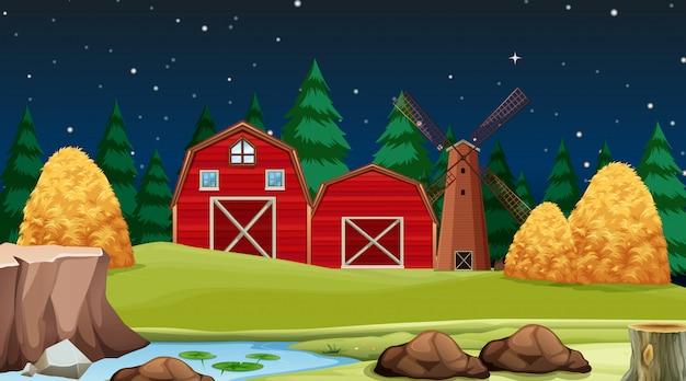 Grange rouge sur la scène de la ferme
