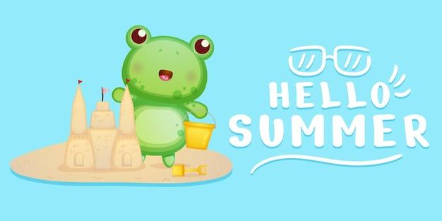 La grenouille mignonne fait le château de sable avec la salutation d'été