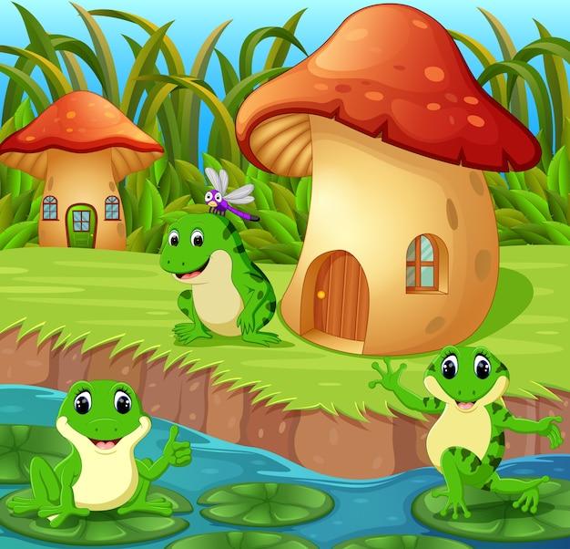 Grenouilles autour d'une maison de champignons