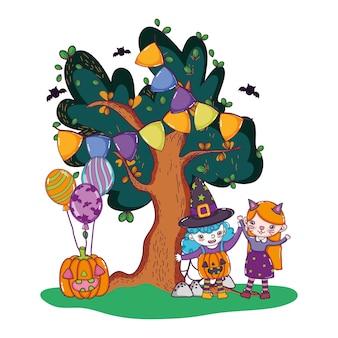 Grils avec des costumes et citrouille avec des ballons et des arbres