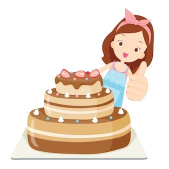Gros gâteau avec fille thump up, nourriture et boulangerie