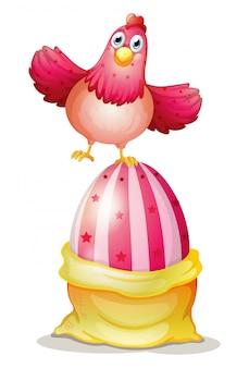 Un gros œuf de pâques et une poule