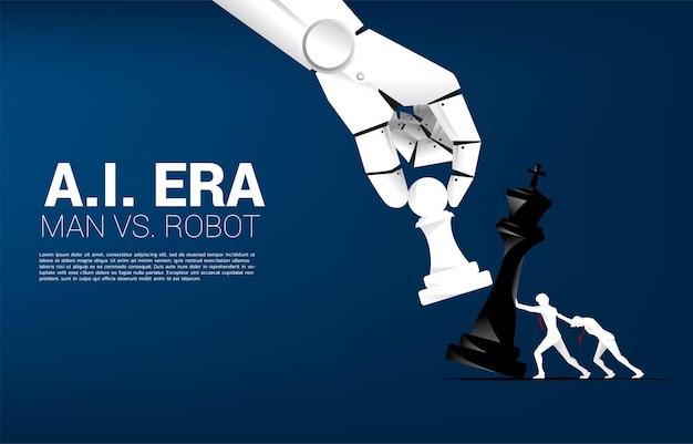 Gros plan sur une main de robot qui essaie de faire échec et mat au jeu d'échecs de l'homme. concept de perturbation de l'ia et de l'homme contre l'apprentissage automatique