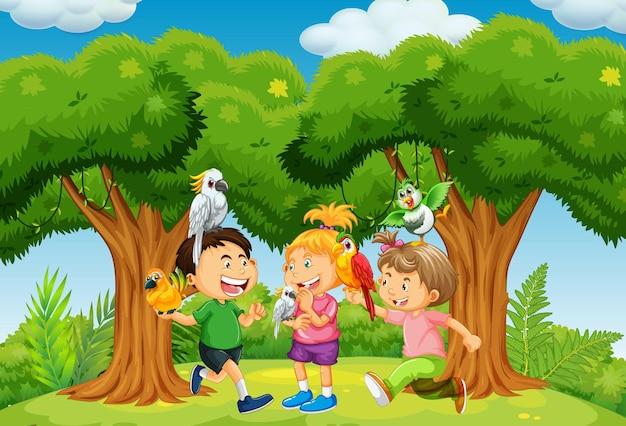 Groupe d'enfants jouant avec leur animal de compagnie dans la scène du parc