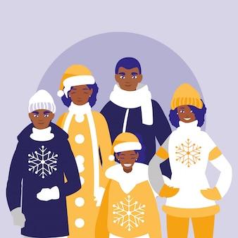 Groupe de famille noir avec des vêtements de noël