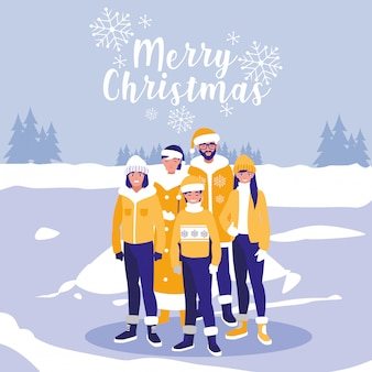 Groupe de famille avec des vêtements de noël dans un paysage d'hiver