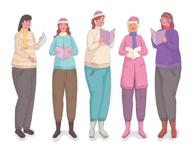 Groupe de femmes chantant des chants de noël