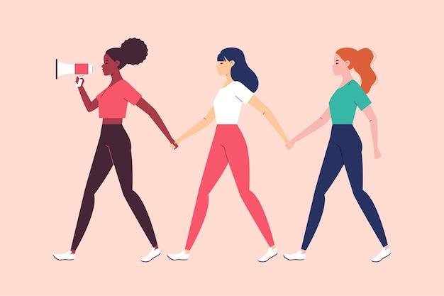 Un groupe de femmes de différentes nationalités marche et se tient la main