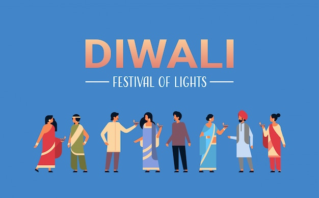 Groupe de gens indiens heureux diwali portant des vêtements traditionnels nationaux tenant bannière de pétrole