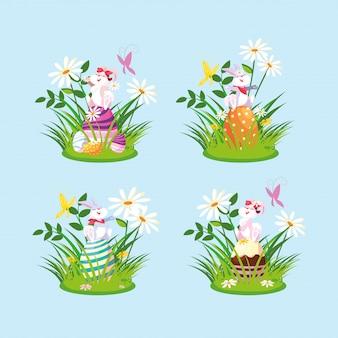 Groupe de lapins avec des oeufs de pâques dans le jardin
