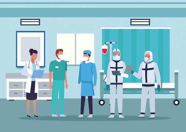 Groupe de médecins portant des masques médicaux dans la chambre d'hôpital