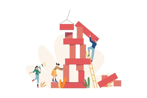 Groupe de personnes construisent des blocs de forme aléatoire