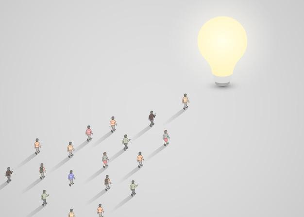 Un groupe de personnes marchant vers une ampoule