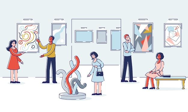 Groupe de personnes visitent la galerie d'art