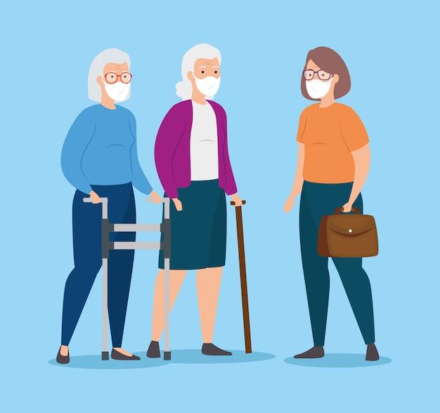Groupe de vieilles femmes avec protection respiratoire