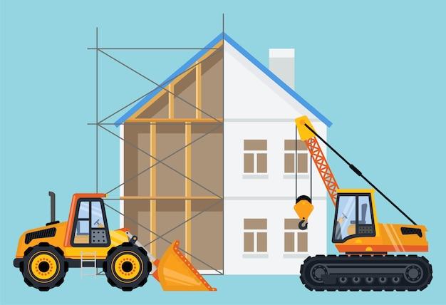 Grue et bulldozer avec bâtiment en cours