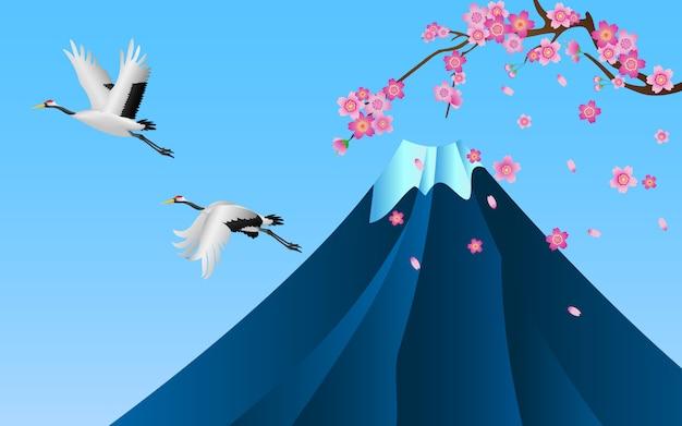 Grues japonaises survolant la montagne fuji