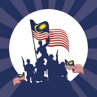 Guerriers de célébration de merdeka agitant des drapeaux