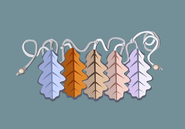 Guirlande sur une corde blanche avec des feuilles de chêne de différentes nuances
