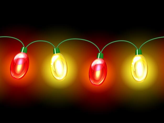 Guirlande festive de lampe multicolore. transparente sur fond noir