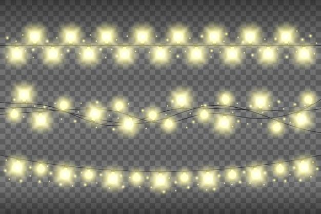Guirlande réaliste jaune de noël s'allume sur un fond transparent. décoration lumineuse de guirlande lumineuse avec des étincelles