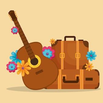 Guitare et bagages avec des fleurs