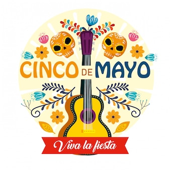 Guitare avec décoration de crânes et fleurs pour un événement mexicain