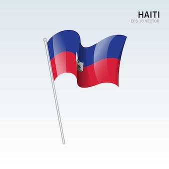Haïti, brandissant le drapeau isolé sur gris