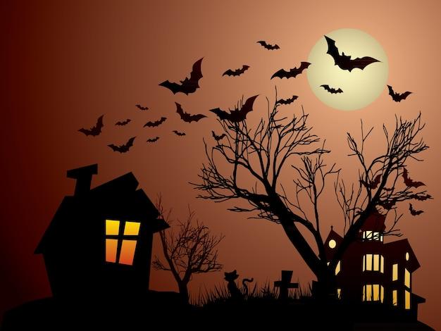 Halloween avec une maison hantée, des chauves-souris et des chats