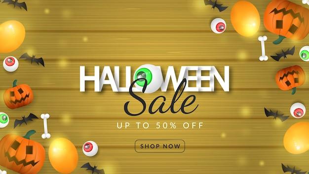 Halloween vente bannière citrouille sur fond de bois
