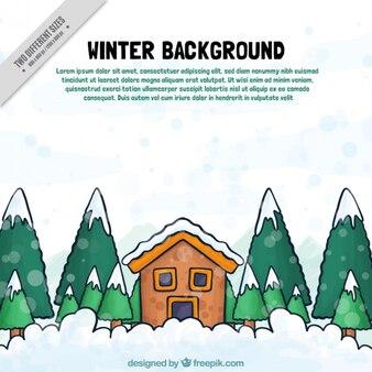 Hand-drawn fond l'hiver avec la maison et les arbres